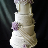 Wedding Cake With Purple Roses