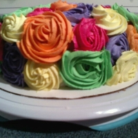 Spring Colored Rosette Cake White 8 in round double layer. with the Rosette tip the 1M. I love doing this! It is so easy and Fun! I had several orders for this same...