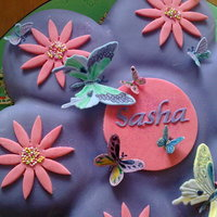 Purple Butterfly Birthday Cake A friends asked for a butterfly themed birthday cake for her 3year old niece. The little girl loved the cake ! I think the mother saved a...