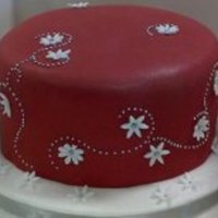 Red Birthday Cake With Silver/white Decor BIrthday cake - Sponge, covered in red coloured Regal Ice, decorated with white icing flowers and silver eadible mini beads.