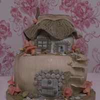 Fantasy Cottage I would love to do a large 5 tier version of this with a tree and lots of flower, great at a wedding!!