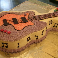 Guitar Cake truffle cake covered in butter cream icing and decorated with chocolate and candymade for poorvi's birthday