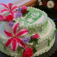 Retirement Cake For My Friend Finished cake with gumpaste roses, leaves, stargazer lilies and blossoms.