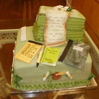 1322247672.jpg This ck was for a fundraiser. Red velvet cake for the base. The books were banana bread. All covered with fondant with gumpaste accessories...