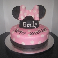Minnie Mouse Cake I made this for my daughter's 2nd birthday. The ears are made from modeling chocolate and the cake is covered in MMF.