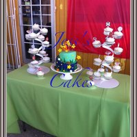 Sport Theme Cake Cup cakes and a topsy turvy cake1