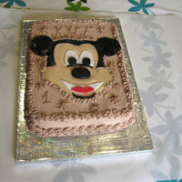 Mickey ganache covered chocolate cake with mickey made of sugarpaste