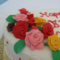 Roses On Heart roses made of gumpaste. buttercream piping and dots and writingi'm still new to piping letters that's why it appears a bit...