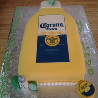 Corona Bottle Cake   Strawberries and creme cake, edible label and fondant/gumpaste details