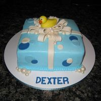 Ducky Baby Shower Giftbox Cake Baby shower cake for my friends! The cake is iced in buttercream with a MMF bow, ducky and lots of bubbles. The bubbles are accented with...