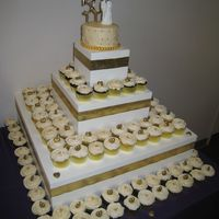 50Th Anniversary Cupcakes/cake 50th Anniversary cupcakes & cake with gold accents. 145 cupcakes but not all of them fit on the stand. I LOVE the stand that was built...