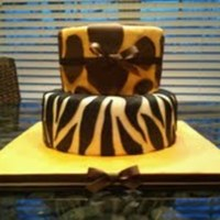 Zebra And Giraffe  This was my 1st tiered cake, and only me second cake ever. I think it turned out quite nice. Top tier was lemon cake and bottom tier was...