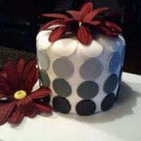 Black And White Polka Dot  I made this one just for fun. Everyone thought it was a candle! All fondant, with artificial flower. Thanks Cynfully Sweets for the...