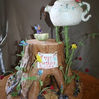 Fairy Tea Party Log with fairies having a tea party. Fairies and pot and log all edible. Another fairy with a little fireplace inside the log. Light...