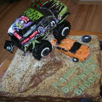 Big Wheel Cake handpainted and all edible but for support to hold truck suspended.