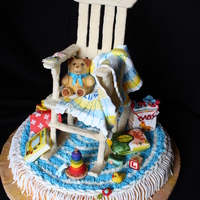 "Ready For Baby White chocolate scultped chair, all details edible and handpainted. Approximately 19"" tall."