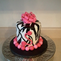 Zebra Cake Black, white, and pink cake with matching cupcakes
