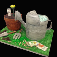 Gardening Cake 3D sculpted cake - both the watering can and plant pot are cake, shaded with petal dustFondant gardening tools and sunflower bud