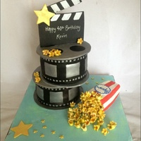 Movie Themed Cake Cake for a movie loverCake film reels and pop corn with fondant movie clapper