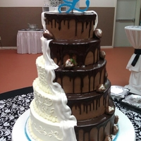 Bride/groom Cake Bride found a picture of this two toned cake and wanted it. Alt layers of vanilla and chocolate cake. Iced in buttercream and chocolate...