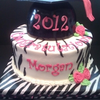 Zebra Graduation Zebra print and hot pink graduation cake, inside was also pink and zebra stripped.