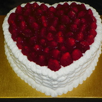 A Valentines Day Special Lemon Cake With Lemon Curd Filling Buttercream Icing Basketweave And Fresh Glazed Strawberries On Top A Valentines Day Special. Lemon Cake with Lemon Curd filling, buttercream icing (basketweave), and fresh glazed strawberries on top.