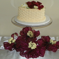 "Simple Wedding The ""Bride's Cake"" to take home. Basket weave with burgundy roses and white calla lilies."