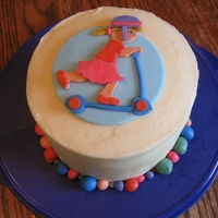 Scooter Girl Rocks! Vanilla cakes cover in butter cream with fondant topper and 'rocks' around the base of the cake.