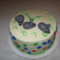 Hickory Dickory Dock Clock Cake Buttercream cake decorated with fondant mice and dots