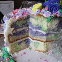 Buterflies And Flowers Rainbow Vanilla purple and green marble cake covered with Buttercream icing and fondant accents