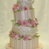 Old Fashioned Romance   Inspired by an old-fashioned tea party. Tilted tiers with handmade gumpaste flowers filling the spaces.