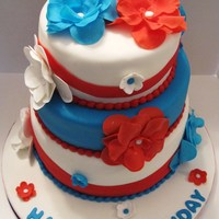 Independence Day Birthday Cake 9 inch, 8 inch and 6 inch tiers covered in fondant with gumpaste flowers.