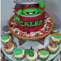 Tmnt Cupcake Tower A smaller version of my TMNT cake with Caleb's favorite turtle (Raphael), for on top of a cupcake tower. I also made 48 cupcake...