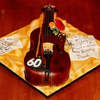 Violin/fiddle Cake White Chocolate and Fresh Raspberry Cake carved as a fiddle for a 60th birthday.
