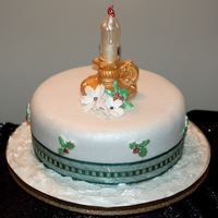 Christmas Cake Traditional Fruit Cake covered in Fondant and decorated with a 3D edible candle and Christmas Flowers