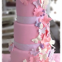 Cascading Butterflies Coconut cake with raspberry filling for 100 guests - cascading butterflies in pinks , purples, whites & pearls. ... There is a hint of...