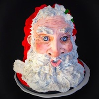 3D Sculpted Santa This santa head is completely edible - He is first sculpted of vanilla cake with strawberry filling - this his face was sculpted separately...