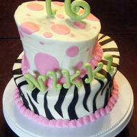 "Topsy-Turvy Sweet Sixteen Birthday Cake   Two tier topsy-turvy cake with gumpaste ""16"" and letters."
