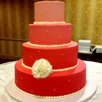 Wedding Cakes   Ombre 4 tier buttercream cake with sugar pearls and handmade gumpaste fantasy flower