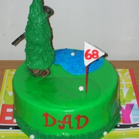 My Dad's Birthday Cake He tends to throw his clubs sometimes, that's why it's in the tree