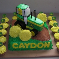 John Deere Tractor I made this cake for a little boy turning 2. The tractor is rice crispy treats covered with fondant.