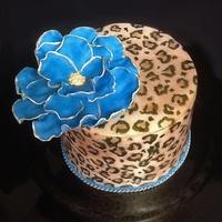 Leopard Print With Fantasy Flower Birthday cake for SIL. Vanilla butter cake with chocolate leopard spots inside. SMBC, covered with MMF. Flower is made from candy clay.