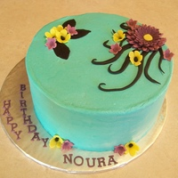 Noura Cream cheese buttercream covered carrot cake. Decorations made from modeling chocolate.
