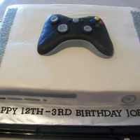 X Box Cake frosted with buttercream with decorations made from modeling chocolate. Controler made out of RKT. The birthday boy was a leap year...