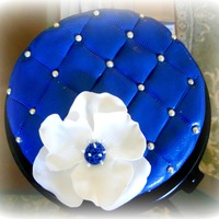 Blue Cake Blue cake, leather imitation, with a white flower.