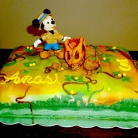 Mickey Mouse Cake. Micky and the dinosaur. Airbrushed cake.