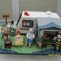 Caravan Camping In England Caravan camping scene modelled for a Golden Wedding anniversary. The raspberry ripple sponge Caravan cake was 16 egg mix. The awning and...