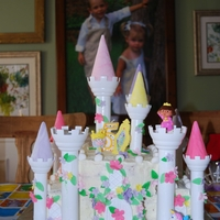 Princess Dora Castle Cake This is a castle cake with Dora the Explorer and Boots the Monkey.