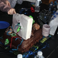 Halo This cake is of the Halo Master chief shooting the X-box game console. The cake is a two layer and the figures are made of fondant. The...