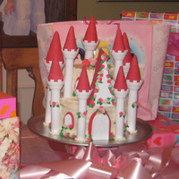 Pink Princess Castle I covered the cake in frosting and added fondant flowers and accents.